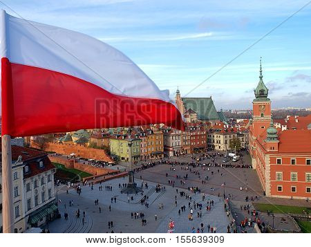 White and red above Warsaw. Warsaw, Poland November 11, 2016 Polish flag over the Old city in Warsaw on Polish Independence Day.
