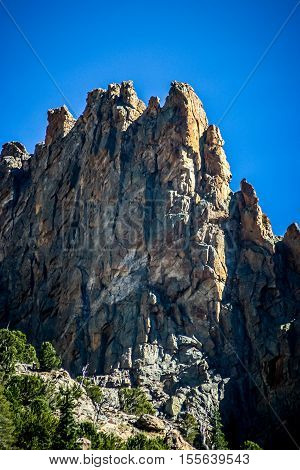 Vertical image of jagged peaks with blue sky in Rocky Mountain National Park, Colorado