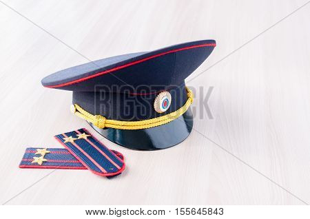 Cap and epaulets of lieutenant colonel are on the table