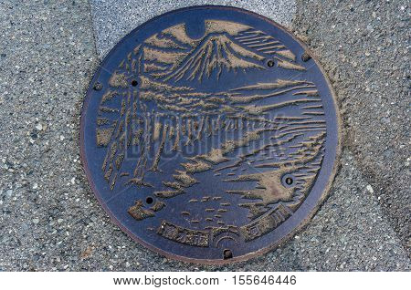 Shizuoka Japan - September 3 2016: Manhole cover design in Shizuoka. Japanese manhole covers come in a variety of designs depending on locality utility type and the manufacturer of the cover