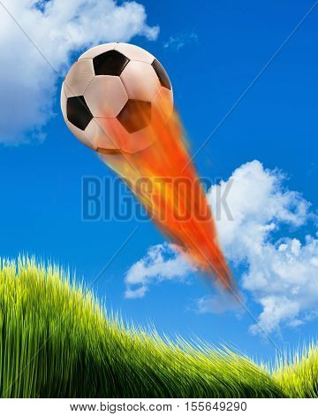 Soccer ball on fire and flying fast in the sky.