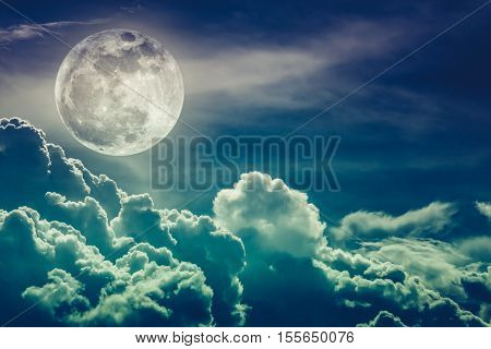 Attractive photo of background nighttime sky and bright full moon with shiny. Nightly sky with beautiful full moon and cloudy. Cross process and vintage tone. The moon were NOT furnished by NASA.