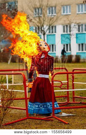 Burning scarecrow. Holiday Maslenitsa folk amusement during the celebration of the spring holiday Shrovetide