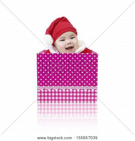 Asian baby cute and smile wearing SantaClaus suit playing in the open pink gift box for surprise on Christmas and Happy New Year day isolated on white