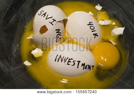Putting all your eggs in one basket savings investments 401k financial planning. Symbolic broken eggs with words written on them representing money management choices and the fragile nature of investments when seeking good financial advice
