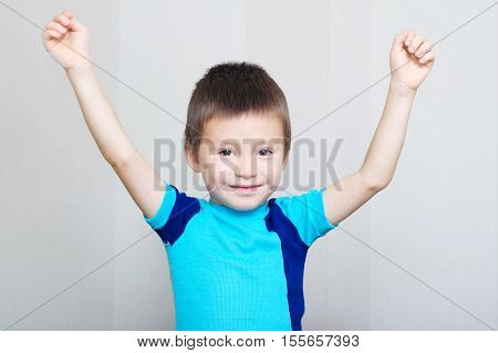 Happy Boy With Hands Up