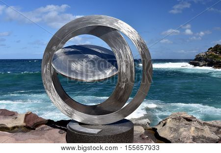 Sydney Australia - Oct 23 2016. Inge King: Celestial rings I. Sculpture by the Sea along the Bondi to Coogee coastal walk is the world's largest free to the public sculpture exhibitions.