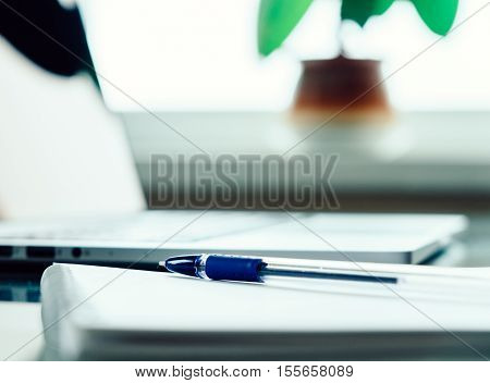 Desk With Laptop, Pen And Notebook