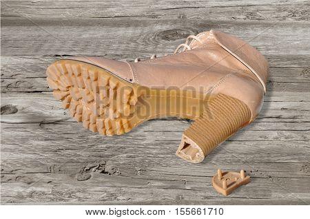 One Shoe With Broken By Heel