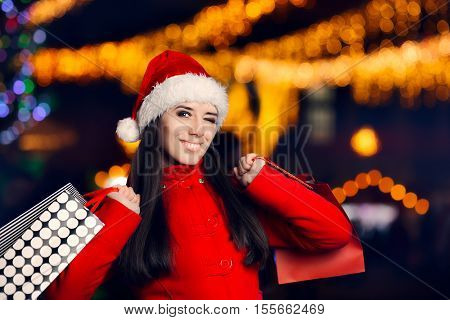 Happy Christmas Woman With Shopping Bags in Xmas Fair