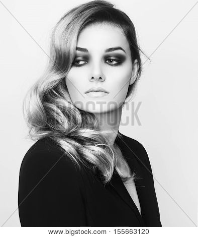 Portrait Of Beautiful Sensual Woman  In Black Jacket With Elegant Hairstyle. Perfect Makeup. Beauty