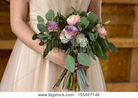 The bride holds a wedding bouquet. The bride's bouquet.