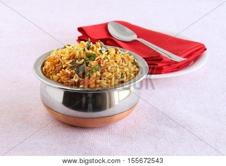 Indian food tamarind rice, which is a vegetarian, traditional, popular and south Indian rice dish, in a bowl.