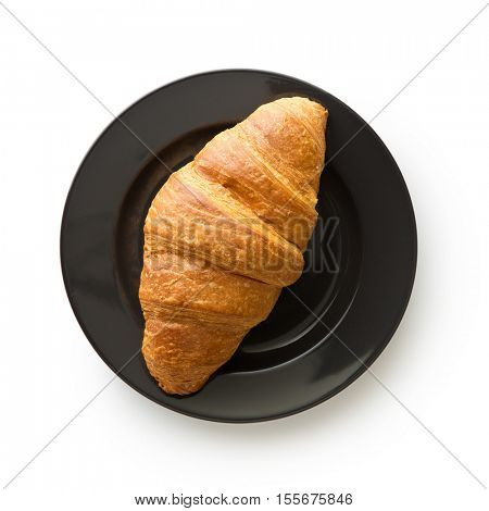 Tasty buttery croissant on plate. Isolated on white background.