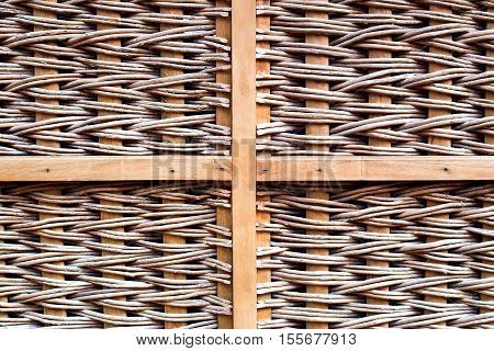 Brown wicker pattern with wooden cross girder. Grid frame. Texture.