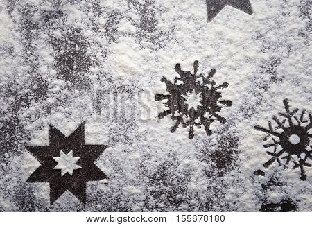 Snowflakes made of flour on grey table, close up view