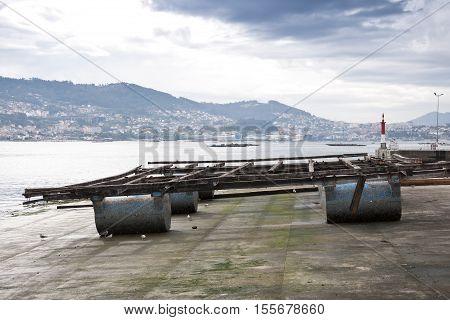 Beached batea: Raft culture of mussels in the Ria of Vigo, Pontevedra, Galicia, Spain