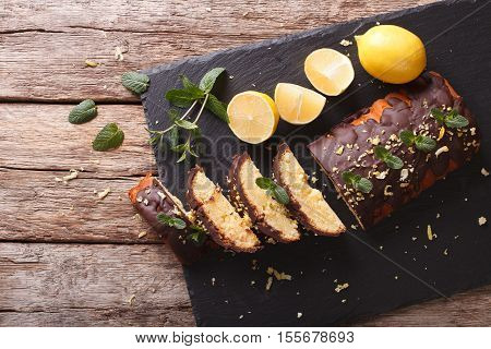 Sliced Lemon Cake With Chocolate And Zest Close-up On The Table. Horizontal Top View
