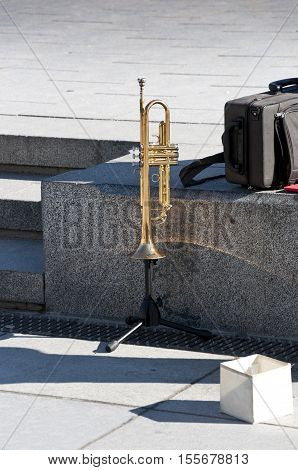 Trumpet in the street. Trumpet over tripod of a street music in Madrid Spain.