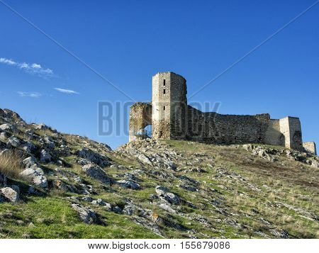 Ruins of ancient Enisala Medieval Fortress also reffered to as Heracleea Fortress in Dobrogea, Romania on a beautiful autumn day with dramatic blue sky