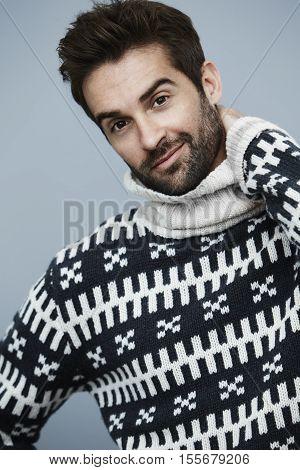 Stubble dude in fashion knitwear studio portrait