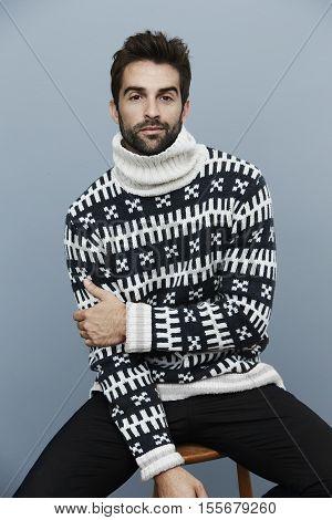Fashion Portrait of cool man posing in knitwear