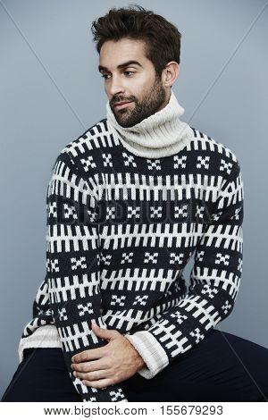 Handsome man in knitwear looking away fashion shot