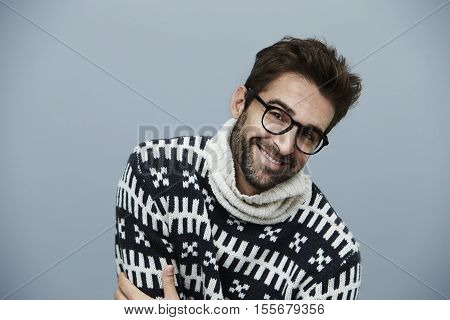 Knitwear and spectacles on happy handsome guy