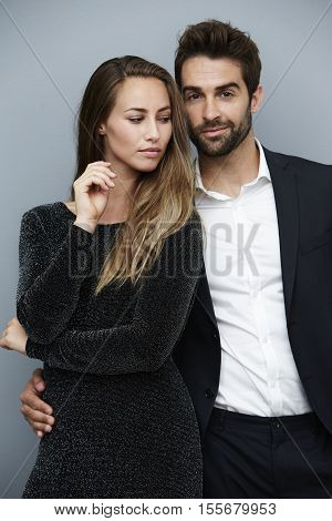 Stunning man and woman in smart clothes