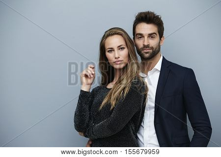 Confident beautiful couple in smart clothing portrait