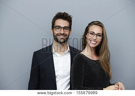 Happy couple with glasses smiling at camera portrait
