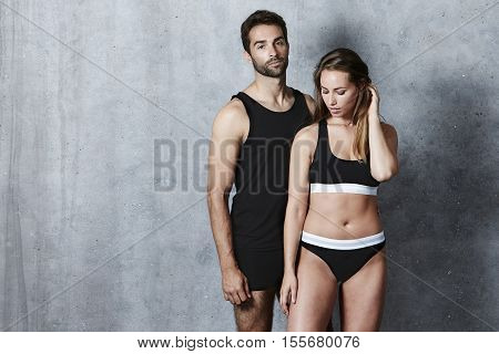 Seriously sexy couple posing in underwear studio