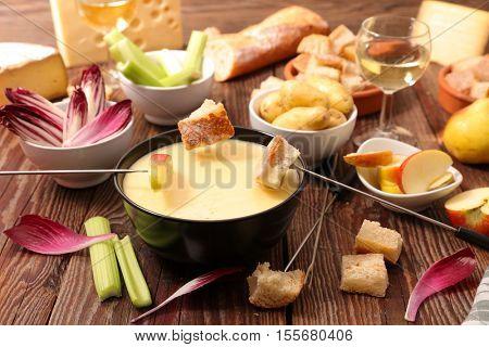 cheese fondue with vegetable,bread,potato