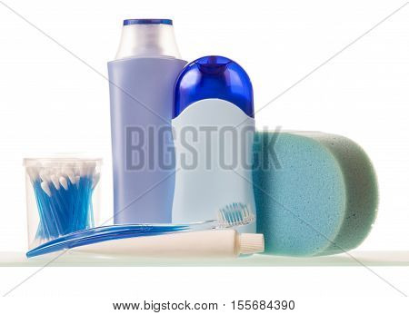 Toiletries: bottles with liquids, toothpaste and brush, cotton swabs, sponge isolated on white background.