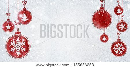 christmas card or new year background made of decorative balls handwritten on snow and red craft paper