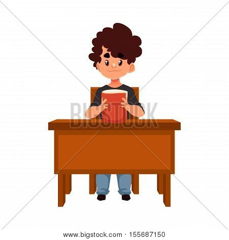 Clever school boy sitting at the desk and holding a book, cartoon style vector illustration isolated on white background. Little boy sitting at the school desk