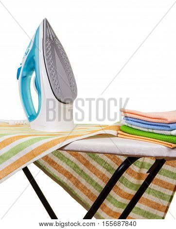 Electric steam iron, ironing board and towels isolated on white background.