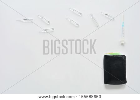 Medical composition with syringe, ampules and purse on white background. Top view of doctor workplace. Flat lay mock up.