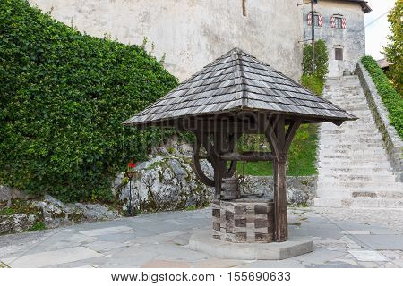 Ancient stone well in Bled Castle Slovenia