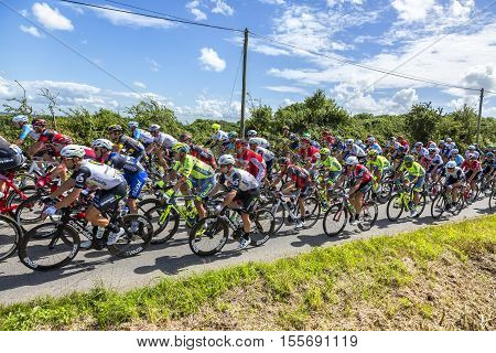 QuinevilleFrance- July 2 2016: The Manx cyclist Mark Cavendish of Team Dimension Data riding in the pack during the first stage of Tour de France in Quineville France on July 2 2016. Cavendish won this stage.