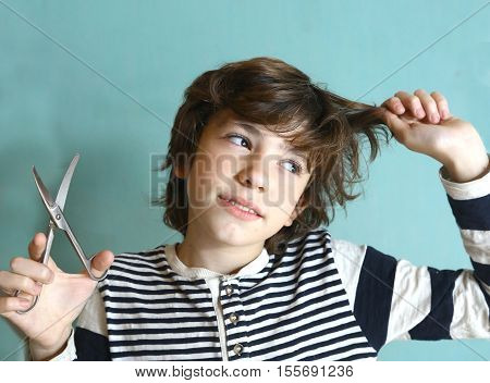 naughty kid cut hair to himself with scissors funny look