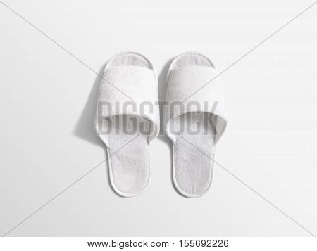 Pair of blank white home slippers, design mockup. House plain flops mock up template top view. Clear domestic sandal. Bed shoes accessory footwear.