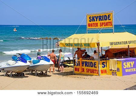 STALIDA, CRETE - SEPTEMBER 14, 2016 - People standing at a water sports tent on the beach Stalida Crete Europe, September 14, 2016.