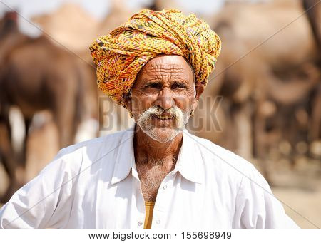 Portrait Rajasthani Indian Man Attends The Pushkar Fair, India.