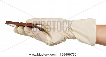 Porous milk chocolate pastry chef in hand isolated on white background.