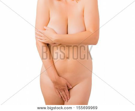 Woman covering her nude body with both hands