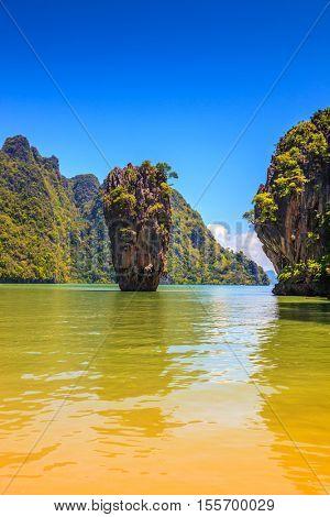 Calm and warm Andaman Sea and the quaint island. James Bond Island. The tourist season in Thailand