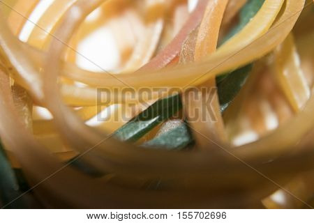 A Colorful Rubber Bands As A Background Close-up