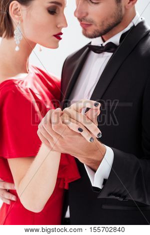 Cropped couple in love. dancing. cuddling. white background