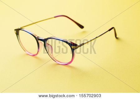 Blue and pink rimmed glasses